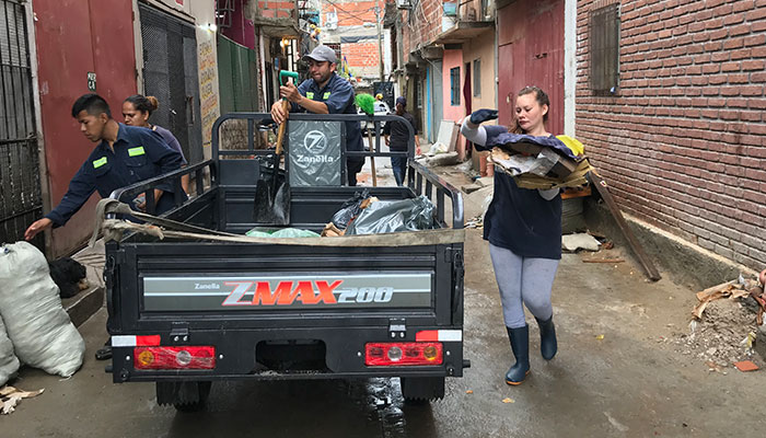 Collection in action: Cooperative members collect recyclables along the narrow streets of Barrio 31 in Buenos Aires